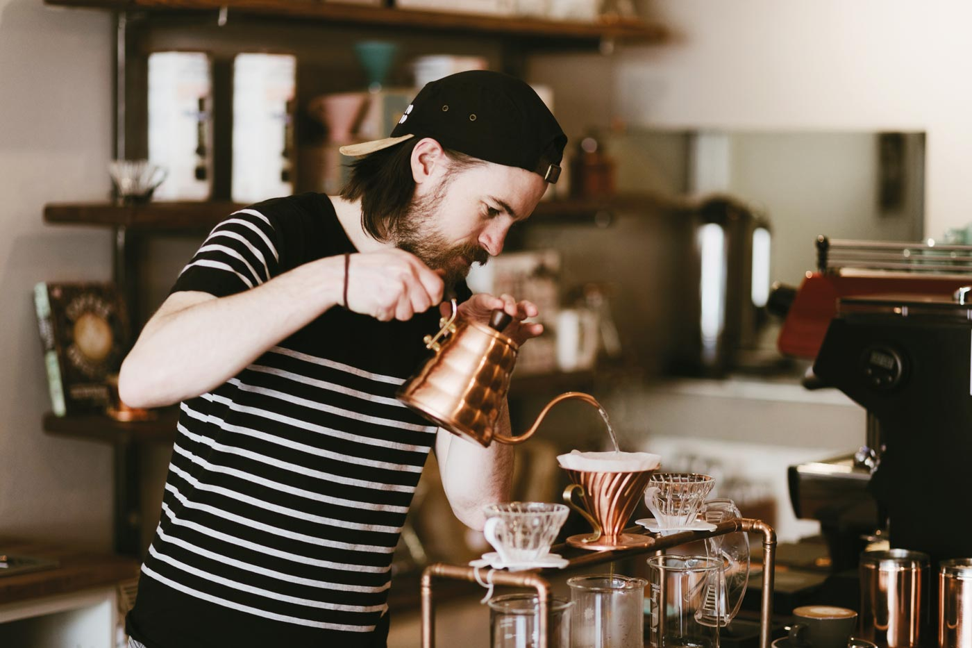 Barista pouring filter coffee